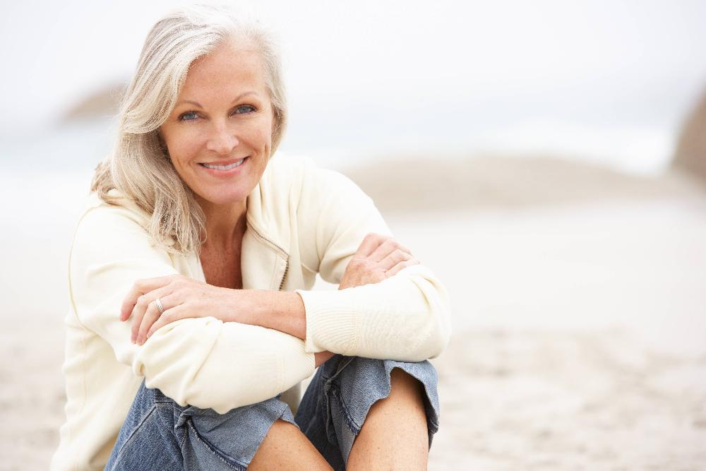 Older woman smiling on beach