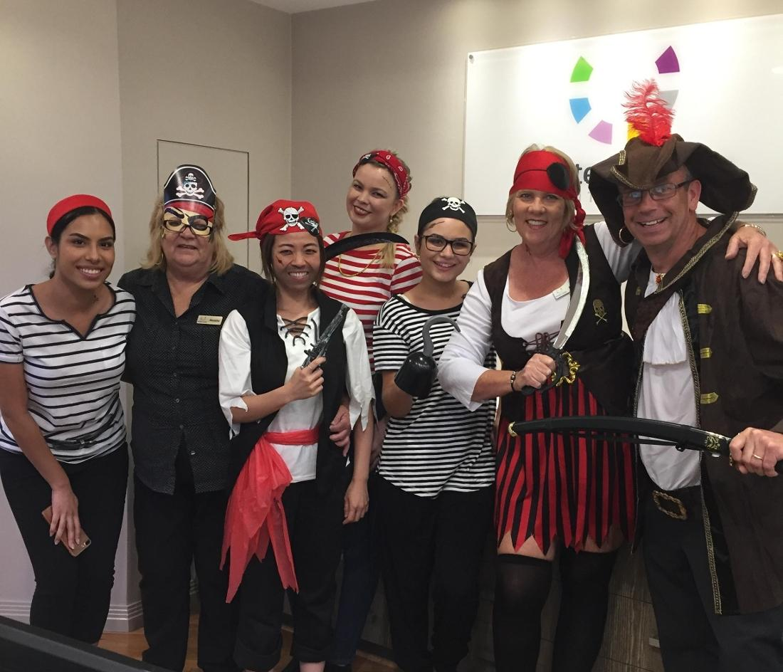Dr Duke and staff celebrating Pirate Day
